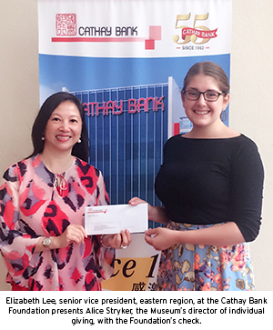 Elizabeth Lee, senior vice president, eastern region, at the Cathay Bank Foundation presents Alice Stryker, the Museum's director of individual giving, with the Foundation's check.