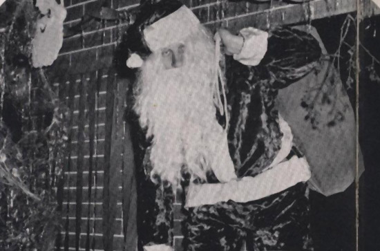 Santa arrives aboard Intrepid in 1954.