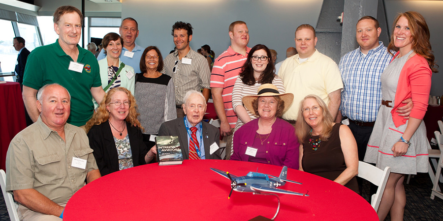 Honoree Ben St. John celebrates with family at a reception after the dedication ceremony.